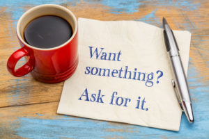 What something? Ask for it. - handwriting on a napkin with a cup of coffee